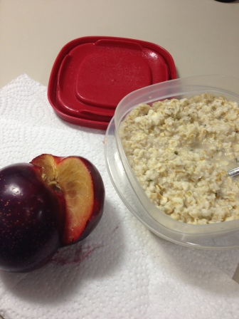 Breakfast - Oatmeal with Hemp Heats and a Plum.  (I have cut my plums in half since I was little.  I don't like holding the pit in my hand after I've eaten around it).